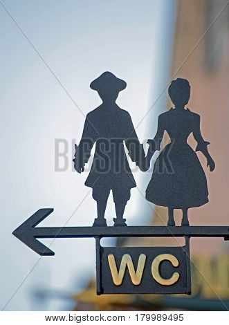 Sign WC with stylized man and woman
