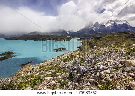 mountains of patagonia at daylight near blue lake from viewpoint Condor with clouded sky