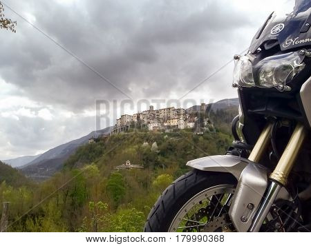 Italy Apennines Umbria Marche Abruzzo - april 24 2015: Panorama of the Apennine hills Umbria-Marche-Abruzzo with motorbike on the side of image.
