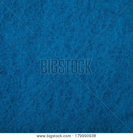 Texture of a blue washcloth macro photo