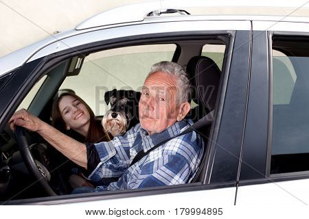 Granfather, Grandchild And Dog In Car