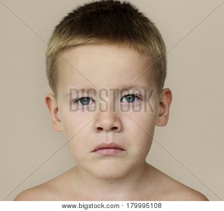 Caucasian Little Boy Frowning Bare Chested