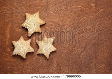 Homemade cookies with sesame on wooden table top view