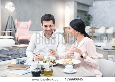 Business meeting. Business people discussing strategy. Businessman and woman in luxury restaurant. They having meal and coffee