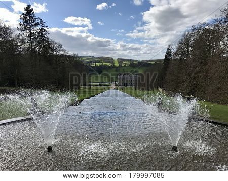 CHATSWORTH HOUSE - MARCH 31, 2017: Fountains at the top of on The Cascade water feature at Chatsworth House in the Derbyshire Dales area of the Peak District, Derbyshire, UK.