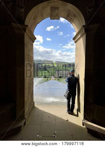 CHATSWORTH HOUSE - MARCH 31, 2017: The Cascade water feature viewed from inside Cascade House in the gardens of Chatsworth House in the Derbyshire Dales, Peak District, Derbyshire, UK.