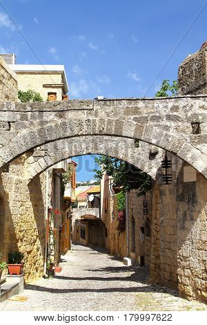 Street of the old city of Rhodes with lintels protecting from earthquakes. Greece