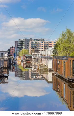 Houseboats on a canal in the center of Groningen Holland