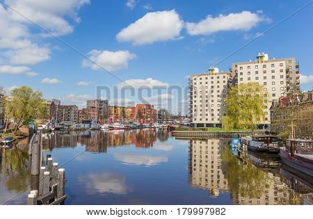 Apartment buildings with reflection in the water in Groningen Holland