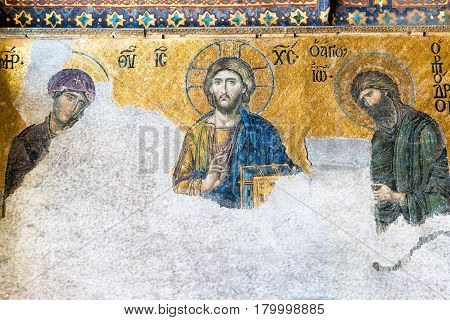ISTANBUL - MAY 25, 2013:  Ancient mosaic in Hagia Sophia in Istanbul, Turkey. Hagia Sophia is the greatest monument of Byzantine Culture. It was built in the 6th century.