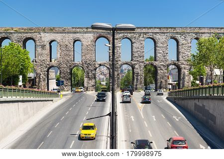 ISTANBUL - MAY 26, 2013: Aqueduct of Valens on may 26, 2013 in Istanbul, Turkey. It was built by the emperor Valens in the late 4th century and is one of the most important landmarks of the city.