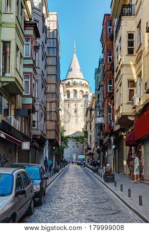 ISTANBUL - MAY 26: View of the Galata Tower on May 26, 2013 in Istanbul, Turkey. The Galata Tower is a medieval stone tower one of the city's most striking landmarks.