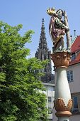 Ulm Minster spire with St Christopher Statue (1584) foreground Germany poster