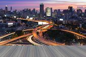 Opeing wooden floor Twilight city office downtown and highway intersection Bangkok Thailand poster