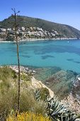 moraira mediterranean turquoise sea high view in Alicante Spain poster