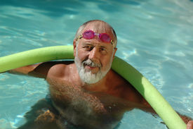 Older Swimmer In The Pool