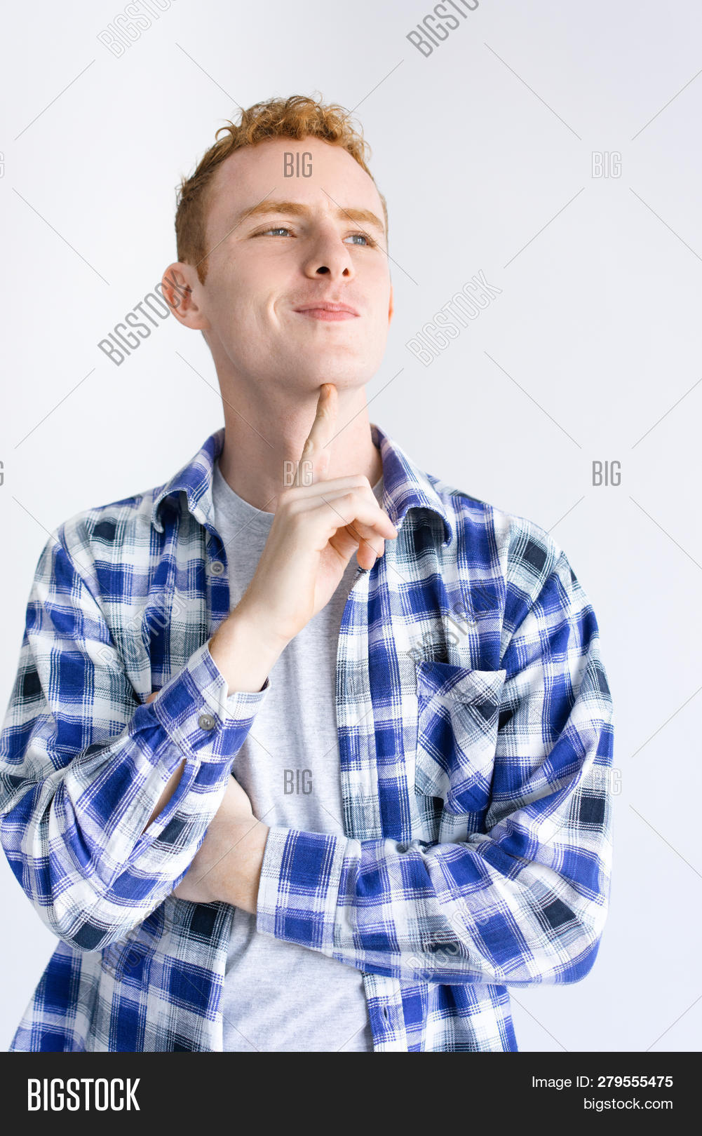 4203aa96 Dreamy young man smiling and touching chin. Arrogant guy wearing chequered  shirt and looking away. Anticipation concept. Isolated front view on white  ...