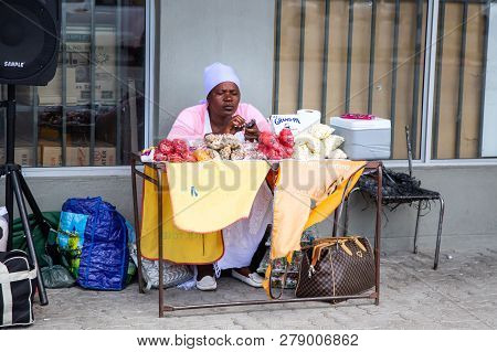 Francistown, Botswana, 7 January - 2019: Informal Trader On The Street Selling Fruit And Air Time Fo