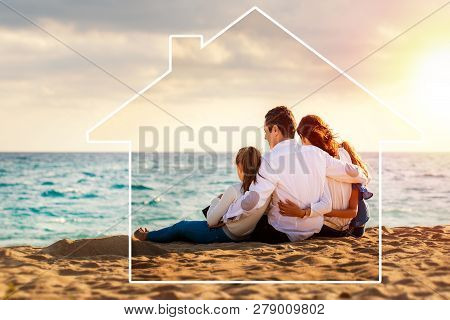 Conceptual Late Afternoon Outdoor Portrait Of Young Parents Sitting On Beach With Kids.foursome Givi