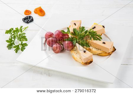 Terrine of delicious foie gras with fig jam on a white wood background poster