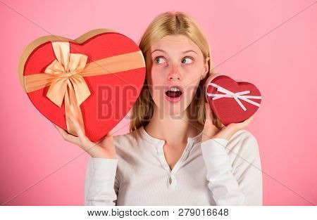 Listen To Your Heart. Girl Decide Which Gift She Like More. Big Surprise And Small Gift. Make Choice