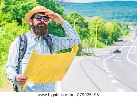 Old School Navigation. Backpacker Use Paper Map For Navigation. Orienteering Topographic Map. Touris