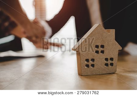 Realtor - Real Estate Broker Manager Handshake To Customer After Signing Contract For Buying House I