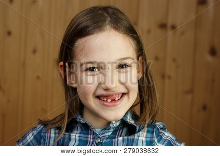 Child Smiling, Showing Her Missing Milk Teeth