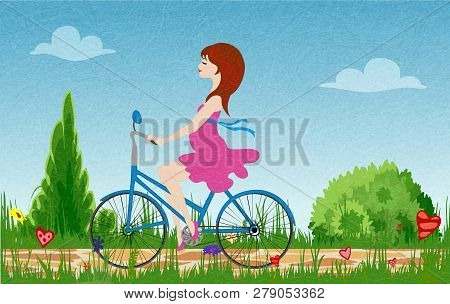 Pregnant Young Woman Riding Bike On Spring Flowering Field. Cobbled Path Through Blooming  Meadow. S