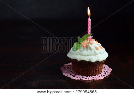 Chocolate Cupcake With Vanilla Cream And Candle. Happy Birthday. Dark Photo