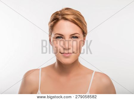 Beauty Woman Face Portrait. Blonde Female Looking At Camera On White Background.