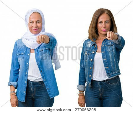 Collage of beautiful middle age arab woman over isolated background Punching fist to fight, aggressive and angry attack, threat and violence