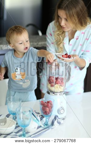 Mom And Toddler Are Cooking Smoothie As Their Version Of Healthy Beakfast
