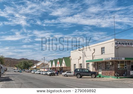 Williston, South Africa, August 31, 2018: A Street Scene, With Vehicles, People And Businesses, In W
