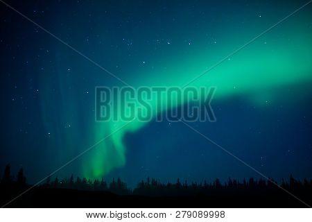 Aurora Borealis As Magical Phenomenon Of Northern Sky, Alaska Travel And Adventure