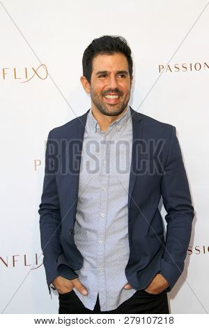 Adrian Gonzales attends the premiere for