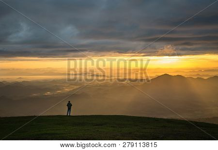 Successful Man Hiker On Top Mountain - Man Standing On Hill With Sunrise / Landscape Mountain With F