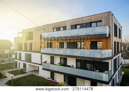 Modern Townhouses In A Residential Area With Multiple New Apartments Buildings Surrounded By Green O
