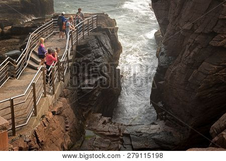Acadia National Park, Me - September 17, 2017: Tourists Check Out Thunder Hole. At The End Of A Natu