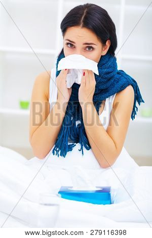 Health Care. Closeup Of Beautiful Ill Woman With Headache, Sore Throat And Fever Covered In Blanket