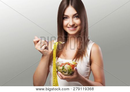 Healthy Lifestyle. A Woman Eats A Salad. Young Woman Eating Healthy Food. Diet. Beautiful And Health