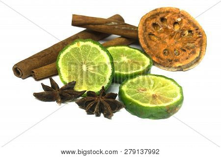 Bergamot Or Kaffir Lime Cut Half With Cinnamon And Star Aniseed Isolate On White Background