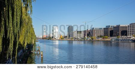 Spree river east side at Berlin, Germany. Industrial area, famous television tower and Oberbaum bridge. Panoramic view, banner.