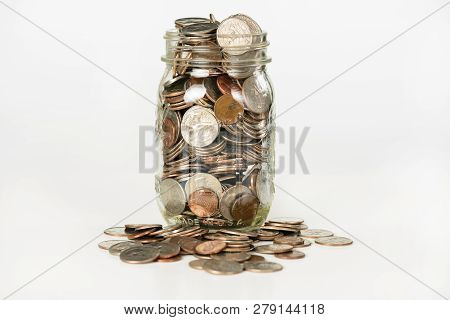 Money In A Glass Jar Isolated On White Background