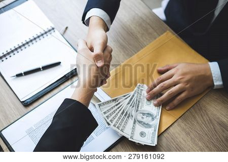 Dishonest Cheating In Business Illegal Money, Businessman Handshake Money Of Dollar Bills In Hands F