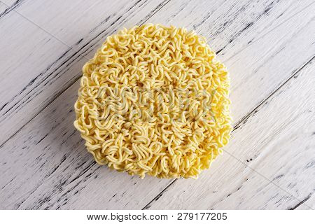 Top View Instant Noodles Or Dried Noodles On White Wood Background