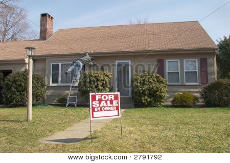 Man Working On Home For Sale