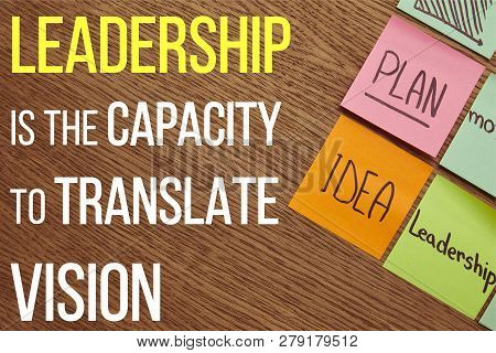 Top View Of Paper Stickers With Words Plan, Idea And Leadership On Wooden Tabletop With Leadership I