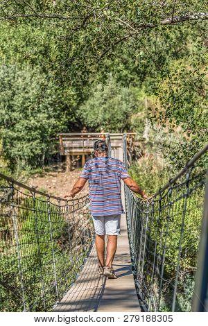 Arouca / Portugal - 10 12 2018 : View Of A Man Walking On Suspension Bridge On Pedestrian Walkway, O