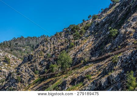 View Of Wooden Suspended Pedestrian Walkway On Mountains, Overlooking The Paiva River, In Arouca, Po
